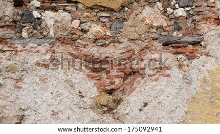 Cracked wall of old house - stock photo