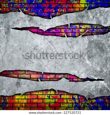 cracked wall with graffiti  - stock photo