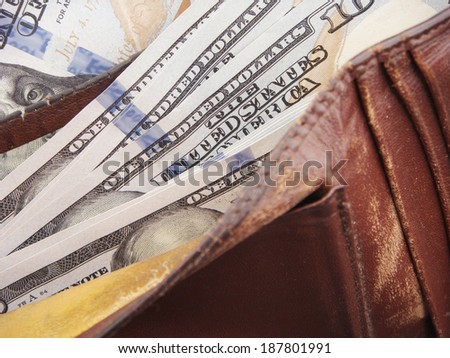 Cracked Wallet Filled With Many United States One Hundred Dollar Federal Reserve Notes.  - stock photo