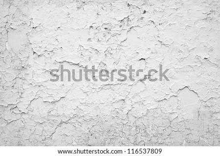 Cracked white wall - stock photo