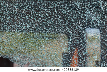 cracked windshield. road accident of car and smashed windscreen  - stock photo