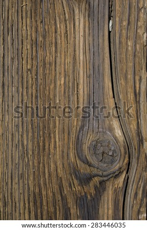 Cracked wooden planks with rustic wood grain flooring. - stock photo