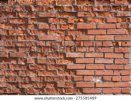 cracked worn red brick wall background - stock photo