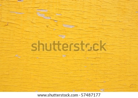 Cracked yellow color on wood board - stock photo