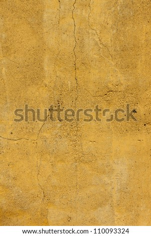 Cracked Yellow concrete wall texture