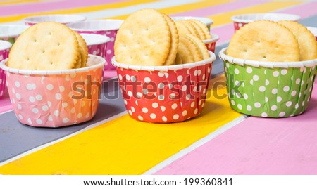 cracker in color paper cup - stock photo
