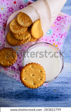 Cracker of a round form on the glass of milk - stock photo