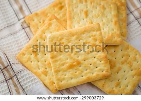 Cracker on a Tablecloth - stock photo