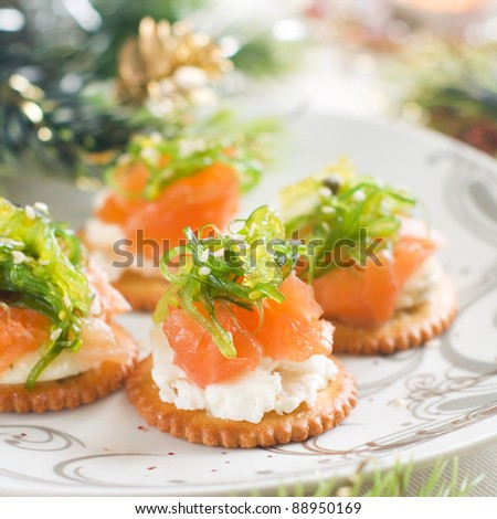 Cracker with cheese and salmon, selective focus