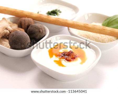 Cracker with different dips and herbs - stock photo