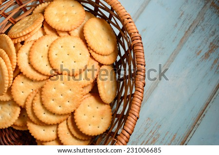 Crackers in wooden basket - stock photo