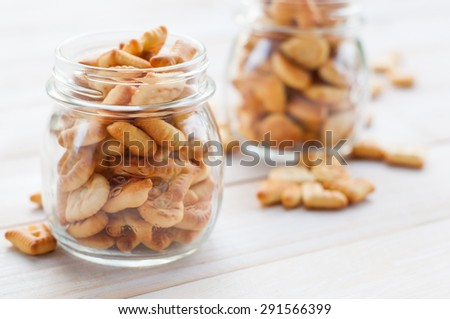 Crackers on wooden board - stock photo