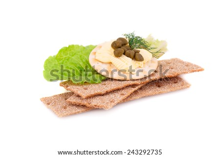 Crackers with fresh vegetables and butter isolated on white background.