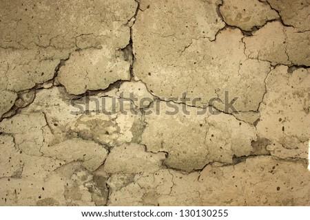 Cracking and peeling whitewash on clay wall - stock photo