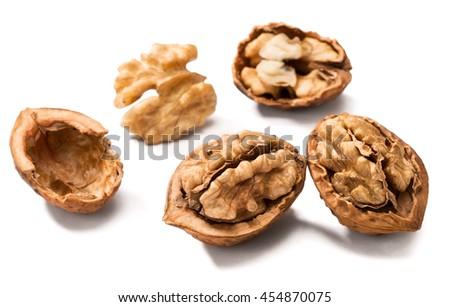 cracking walnuts on white - stock photo