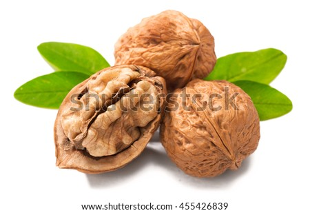 cracking walnuts on white