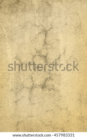 Crackled paint on old rough wall in vintage sepia. - stock photo