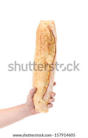 Crackling bread in a hand. Isolated on a white background. - stock photo