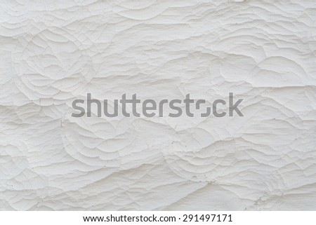 Cracks on white canvas as a background - stock photo
