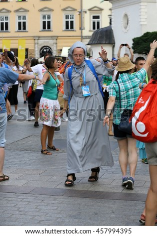 CRACOW, POLAND - JULY 24, 2016: Pilgrims of World Youth Day sing and dance on the Main Square in  Cracow. Poland