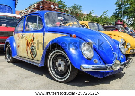 CRACOW, POLAND - July 11, 2015: Row of vintage colorful Volkswagen Beetles from the seventies in Cracow, Poland