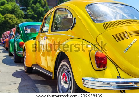 CRACOW, POLAND - July 11, 2015: Row of vintage colorful Volkswagen Beetles from the seventies in Cracow, Poland - stock photo