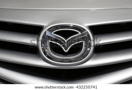CRACOW, POLAND - MAY 21, 2016: Mazda metallic logo closeup on Mazda car displayed at 3rd edition of MOTO SHOW in Cracow Poland. Exhibitors present  most interesting aspects of the automotive industry