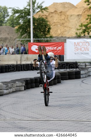 CRACOW, POLAND - MAY 21, 2016: Unidentified young man rides his BMX Bike  at 3rd edition of MOTO SHOW in Krakow.  - stock photo