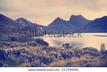 Cradle Mountain, an iconic Australian landscape in glowing sunset light with Instagram style filter - stock photo