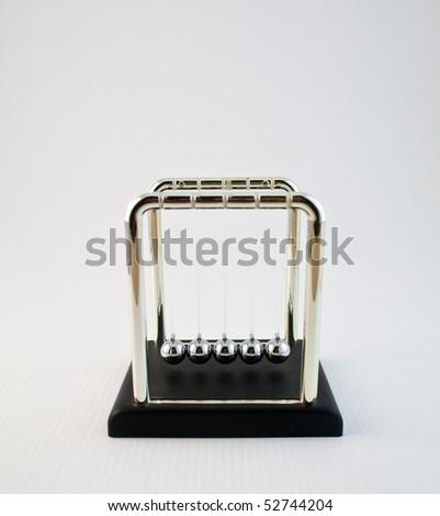 Cradle of Newton on a white ground - stock photo
