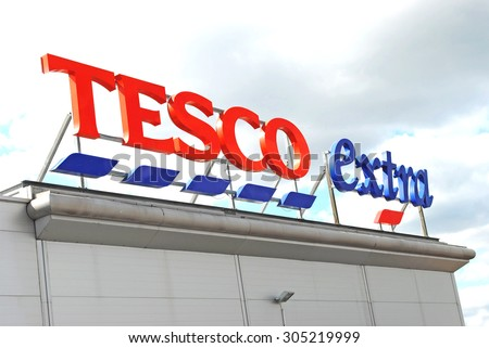 Cradley Heath, West Midlands, UK - August 11 2015: Tesco supermarket sign with logo. Retail food prices are falling with all supermarkets including Tesco cutting their prices.