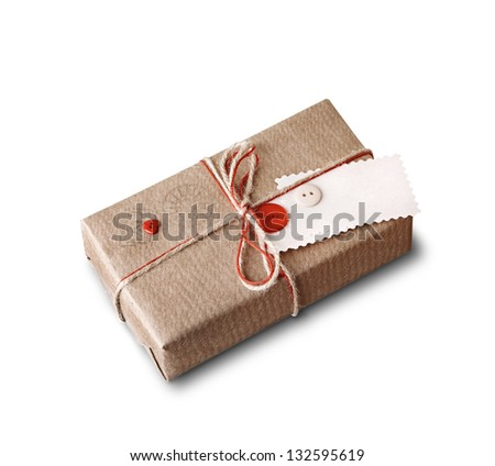 Craft gift box with blank gift tag isolated on white background. - stock photo