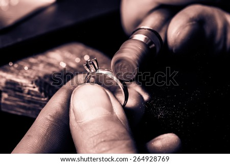 Craft jewelery making. Ring polishing. Macro shot. Monochrome cream tone. Black and white photography. - stock photo