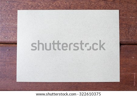 Craft paper on wooden background - stock photo