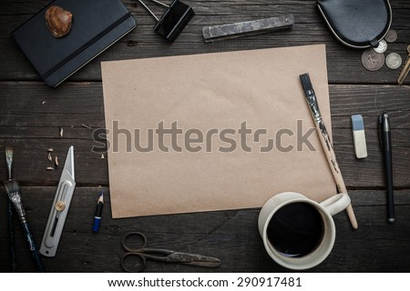 Craft sheet surrounded by vintage elements for drawing - stock photo
