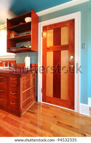 Craftsman build kitchen with wood door and cherry cabinets. - stock photo