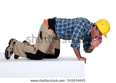 craftsman calling his colleagues - stock photo