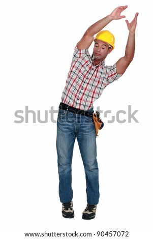 craftsman carrying something and trying to keep balance - stock photo