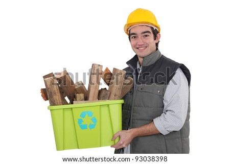 craftsman holding a box with recycling materials - stock photo