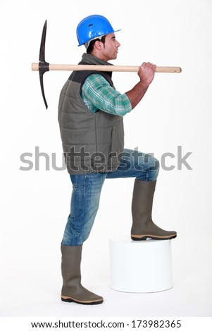 craftsman holding a pick - stock photo