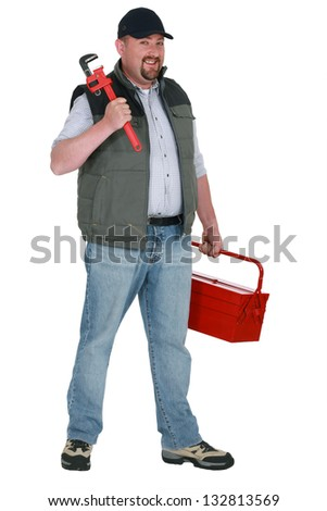 craftsman holding a spanner and a toolbox