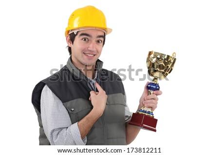 craftsman holding a trophy - stock photo