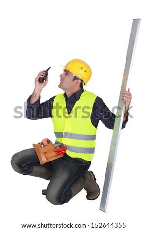 craftsman holding a walkie talkie - stock photo
