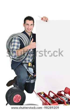 craftsman holding an ad board - stock photo