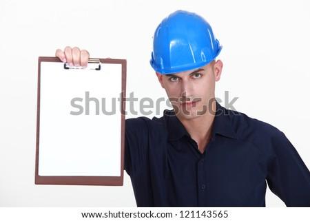craftsman holding clipboard - stock photo