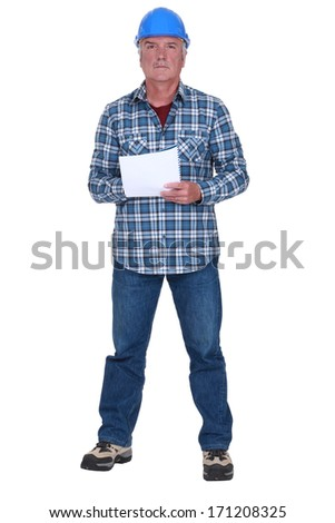 Craftsman holding paper - stock photo