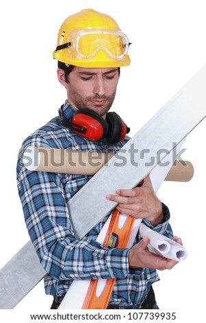 craftsman holding tools and wallpapers - stock photo