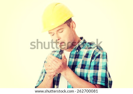 Craftsman in helmet smoking cigarette - stock photo