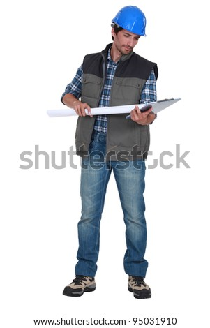craftsman looking at his notepad - stock photo