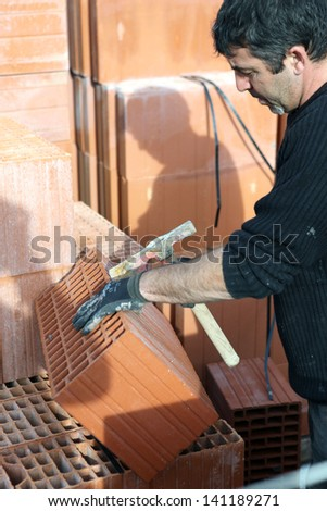 craftsman mason cleaning bricks - stock photo